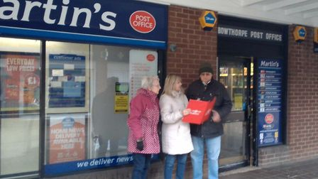 City councillor Sally Button encouraging people to sign a petition to see Bowthorpe post office save