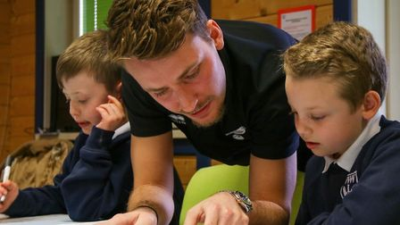 Tom Trybull and pupil at White Woman Lane Primary School in Norwich. Picture: Pitch