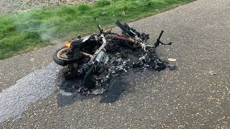 The motorcycle was left burning on Lakenham Way. Picture: Archant
