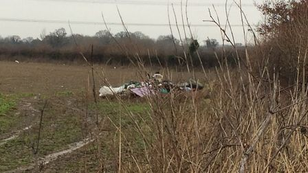 Fly-tipping on private land off Colney Lane near Norwich City's training ground at Colney. Photo: Ar