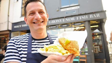 Co-owner Christian Motta with fish and chips from Grosvenor Fish Bar. Pic: Archant
