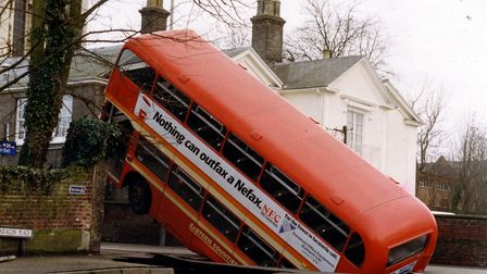The memorable day a bus fell down a hole in Earlham Road in Norwich - 3rd March 1988.Photo: Adrian J
