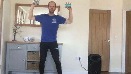 Matt Philpott, of ATP Health and Fitness Norwich, demonstrates you can use any household items as we