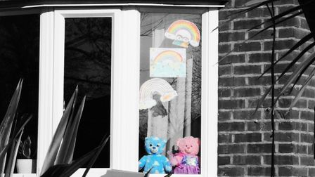 During coronavirus lockdown families place rainbow drawings and teddy bears in their windows to lift