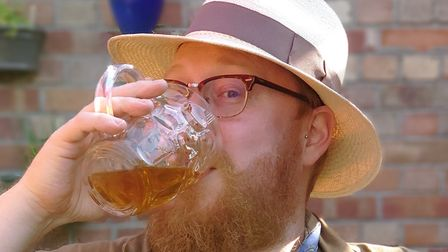 David Waterhouse enjoys a pint from the Fat Cat Brewery Tap on his 'unwedding day'. Picture: Alison