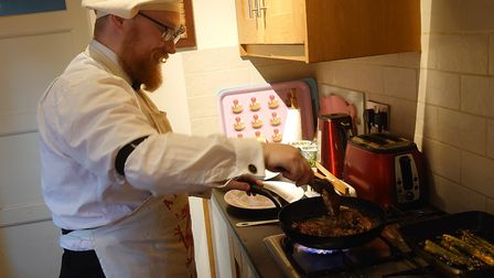 David Waterhouse cooking steak for their 'unwedding day' evening meal. Picture: Alison Newbery and D