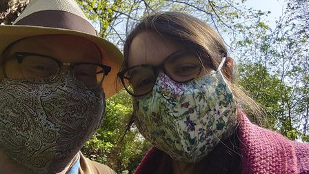 Alison Newbery and David Waterhouse take an 'unwedding day' stroll in their masks. Picture: Alison N