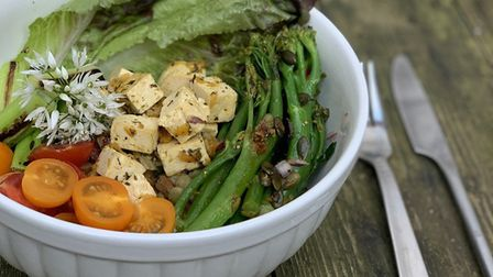 Green lentils with herb dressing, marinated tofu, charred spring onions, sweet tomatoes, sprouting b