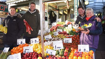 Mike and Debs Read, and their sons, Brendan, left, and James at their family fruit and veg stall at
