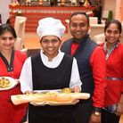 Namaste Village owner Vijay Jetani (second from right). The restaurant is cooking hundreds of meals