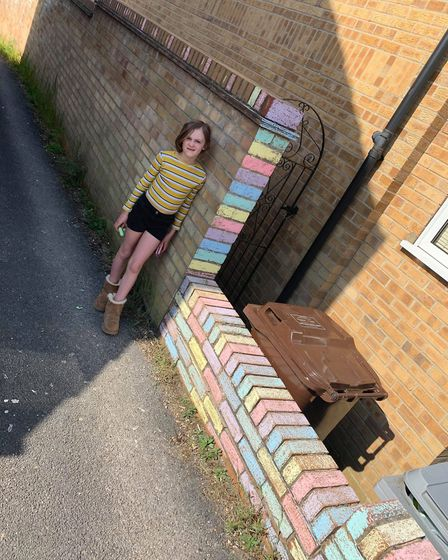 Emily and Sophie Watts have been hard at work colouring in brick walls at their house and their next