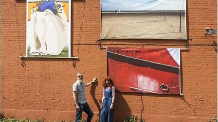 Simon Marshall and Julia Cameron have put their work on the side of the wall at their home in Norwic