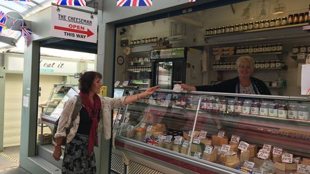 Paula Taylor, owner of the Cheeseman stall on Norwich Market serving Manon Drogz. Picture: Sophie Wy