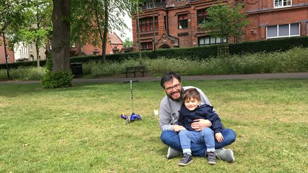 Davide Lombardi, 38, with his two-year-old son Alessandro in Chapelfield Gardens, Norwich. Picture: