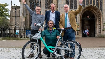 Norfolk county councillors Andrew Jamieson (centre) and Martin Wilby (right) with Beryl bikes CEO Ph