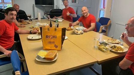 Sprowston firefighters enjoying their free meal from Rishi restaurant in Norwich. Picture: Rishi
