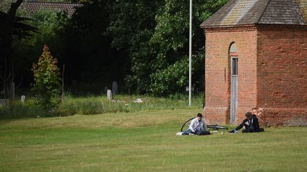 People relaxing in Earlham Park in Norwich on Saturday <23.5.20> of the spring bank holiday. Picture