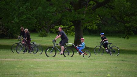 A family cycling in Earlham Park in Norwich on Saturday <23.5.20> of the spring bank holiday. Pictur