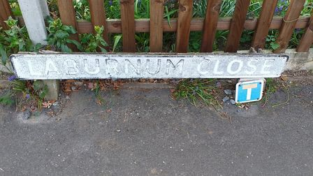 The faded street sign on Laburnam Close before it was restored. Picture: Supplied by the Horsford Ba