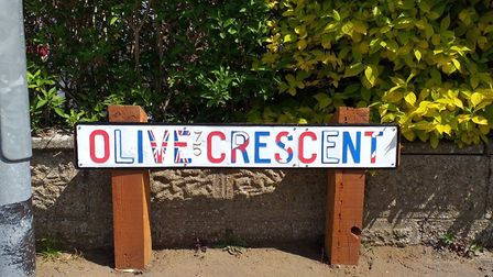 A restored sign on Olive Crescent, painted as a VE Day tribute. The old rotting posts were replaced