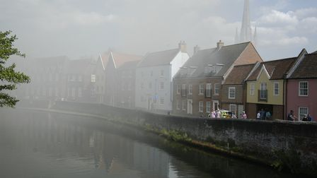 Smoke from thre fire at Fishergate in Norwich drifts across the river. Picture: Simon Parkin