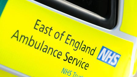 A woman was arrested after trying to bite an East of England Ambulance Service paramedic in Norwich.