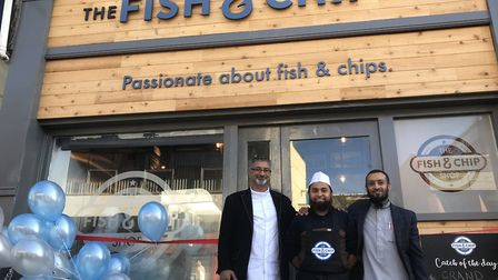 The Fish n' Chip shop in Magdalen Street. From L-R Rafik Hussein, Juber Ali (owner) and Babrul Matin