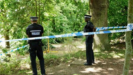 Police at the derelict site of the former St Andrew's Hospital where a woman died in Thorpe St Andre