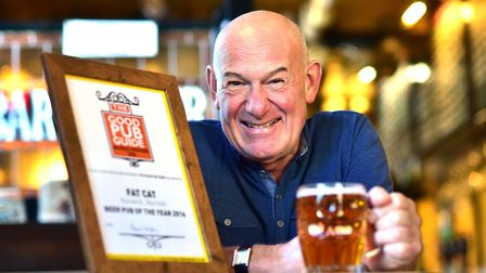 Landlord Colin Keatley celebrates The Fat Cat Pub being awarded beer pub of the year in The Good Pub