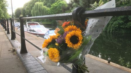 Floral tributes to the 37-year-old man who died after falling from a boat into the River Wensum in N
