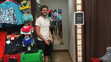 Adam Betts, store manager of Mountain Warehouse on London Street, Norwich, in a fitting room which w