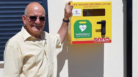 John Fisher, mayor of Thorpe St Andrew, with the new defibrillator. Picture: Thorpe St Andrew Town C