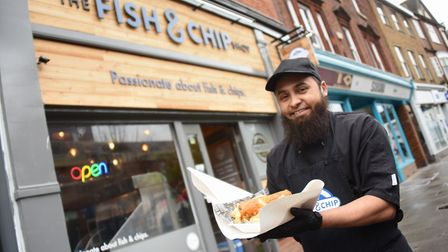 Juber Ali, owner of The Fish & Chip Shop, one of the shops open in Magdalen Street in Norwich. Pictu