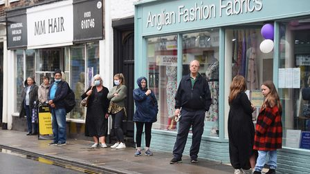 The queue of shoppers for Anglian Fashion Fabrics in Magdalen Street, Norwich. Picture: DENISE BRADL