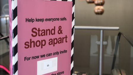 Only 65 people can go into the store. Picture: Archant