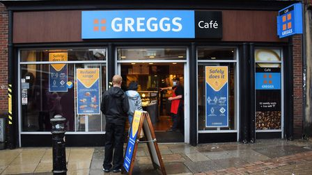 Customers in a queue as the Greggs shop in White Lion Street reopens. Picture: DENISE BRADLEY