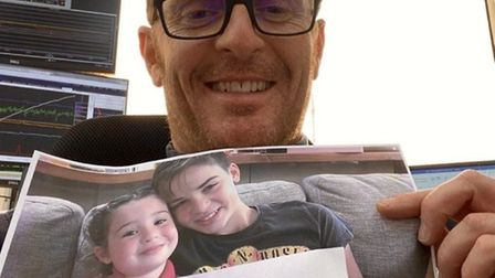 Gary Legg in Saudi Arabia with the 'send a smile' message from his children Florence and Archie who
