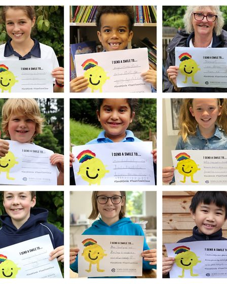 People with the send a smile messages they have sent to loved ones as part of school project. Pictur