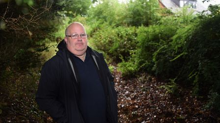 Dean Bailey at the land he is hoping to self-build a house on at Costessey, but has been refused pla