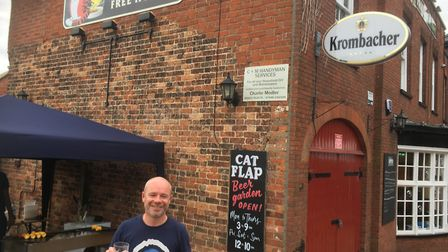 Christian Hodgkinson, landlord of the Fat Cat and Canary, welcoming customers for the first time in
