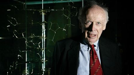 Dr James Watson (2005), who discovered the structure of DNA more than 50 years ago stands next to th
