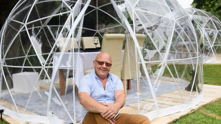 Landlord Jason Carter with the new VIP Pods for dining at the Gibraltar Gardens in Norwich. Picture: