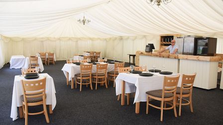 Landlord Jason Carter at the bar of the new fine dining marquee at the Gibraltar Gardens in Norwich.