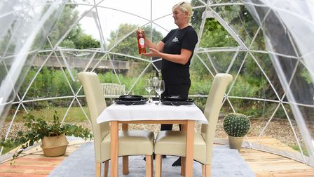Fran Balls, bar manager, sets up one of the new VIP Pods for two dining at the Gibraltar Gardens in