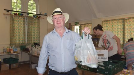 Brian Green, secretary of Unite Community Norfolk, providing school lunches to people who need them