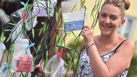 Elaine Day from Attlebrough has set up a mask tree outside her home in the town where people can com