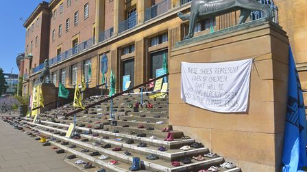 'The Missing Shoes' Extinction Rebellion Norwich symbolically lay out hundreds of pairs of children