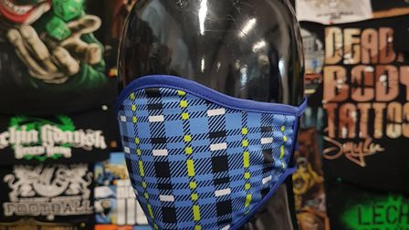 The blue tartan design inspired by a former Norwich City kit. The mask is being sold by independent