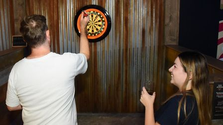 Louisa Baldwin and James Randle have a go at the electronic darts games at the newly opened Boom: Ba