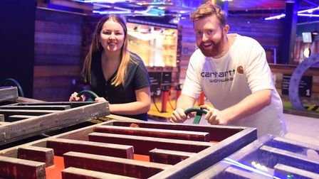 Louisa Baldwin and James Randle play crazier golf at the newly opened Boom: Battle Bar in Norwich's